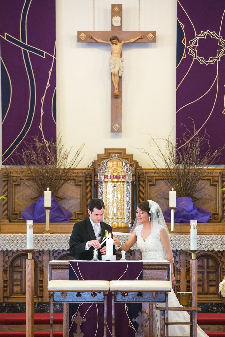 The bride and groom performed a candle lighting ceremony at the altar inside St. Brendan Church in San Francisco, California.