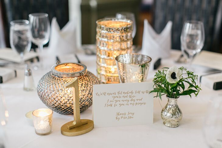 Tablescapes featured a number of different arrangements: jumbo balloons, centerpieces in gold vases, mercury-glass bud vases and tall gold hurricanes, along  with simple gold table numbers.