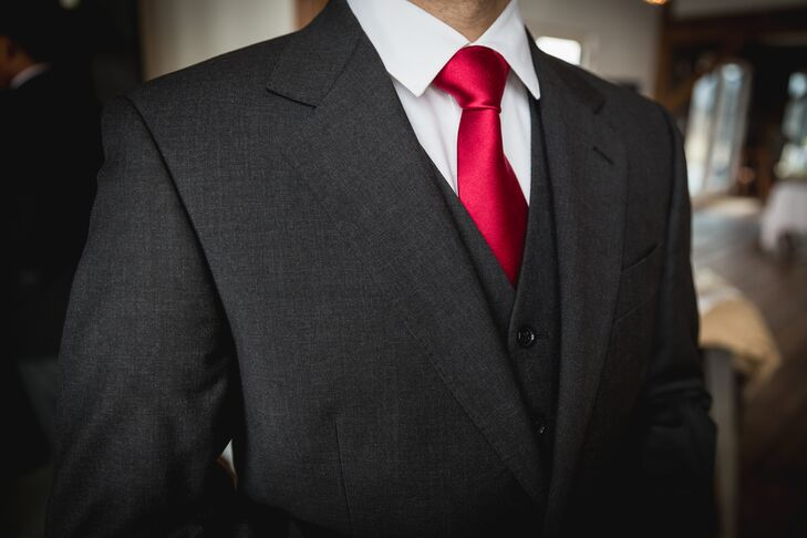 grooms dark gray threepiece suit with red tie