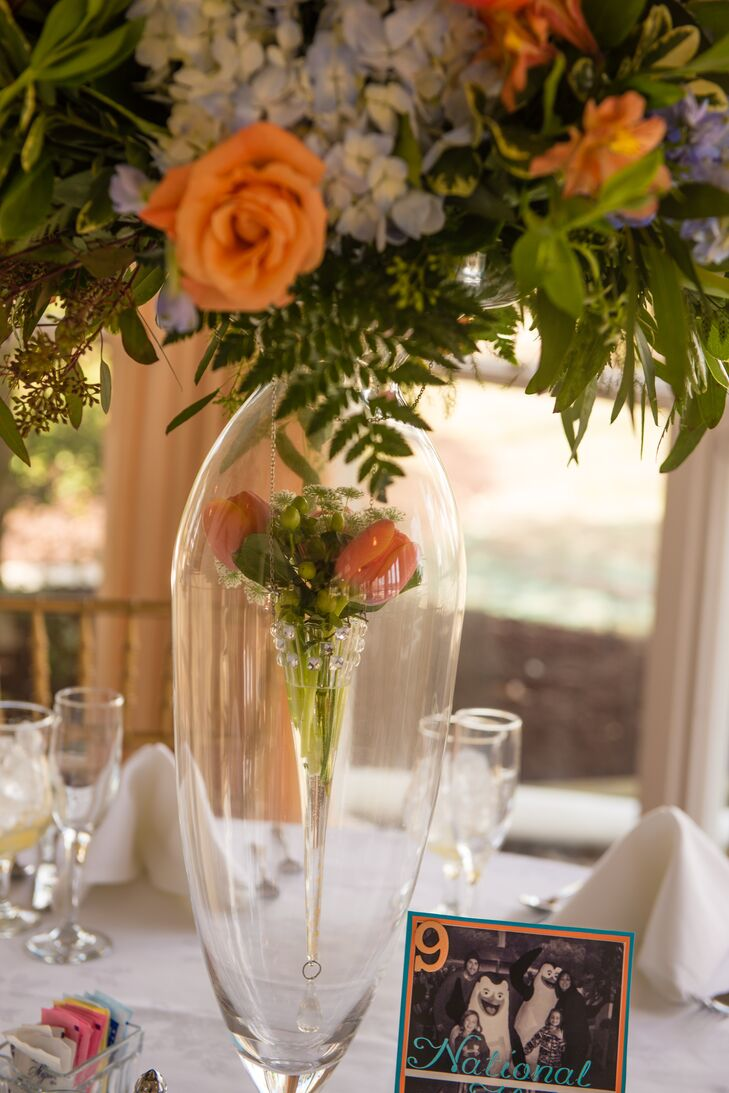 Tall centerpiece with orange flower arrangements izmirmasajfo
