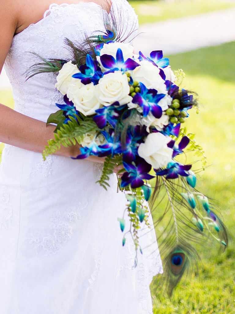 The best blue wedding flowers and 16 gorgeous blue bouquets blue wedding bouquet with roses orchids ferns and peacock feathers junglespirit Images