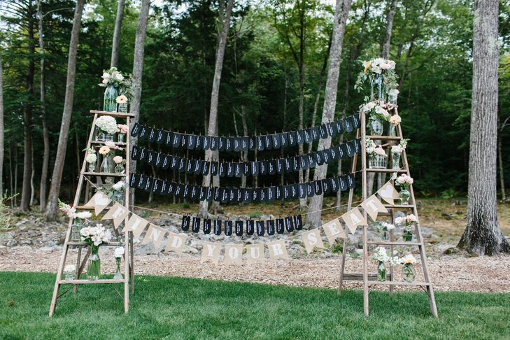 The escort cards were clothespinned from twine strung between two vintage ladders.