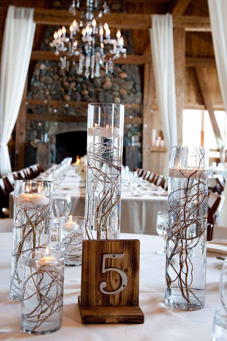 Wispy willow branches gave the floating candle centerpieces a whimsical wintery look.