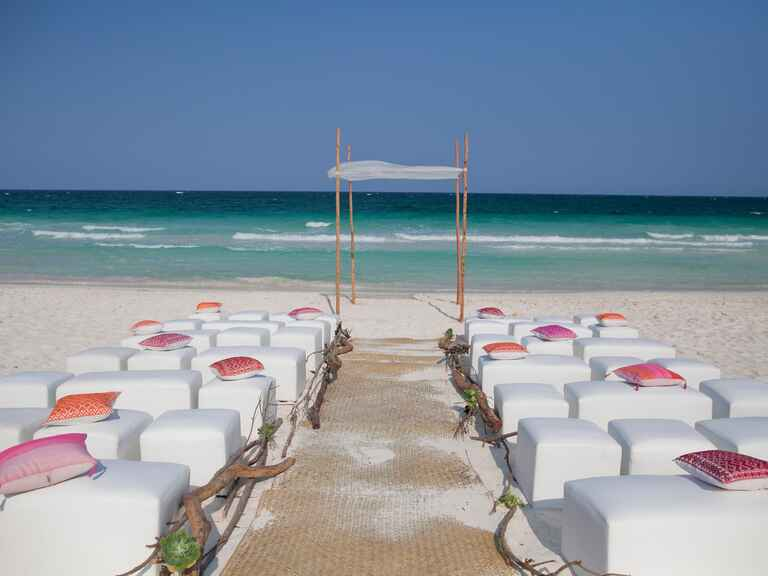 Alison Hotchkiss's beach wedding ceremony with colorful patterned pillow seating