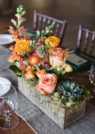 Vintage wooden box centerpiece with succulents and roses