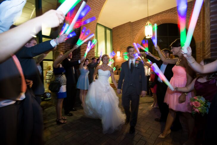 Instead of a traditional sparkler send off, guests waved colorful glow sticks as the couple made their exit from the reception.