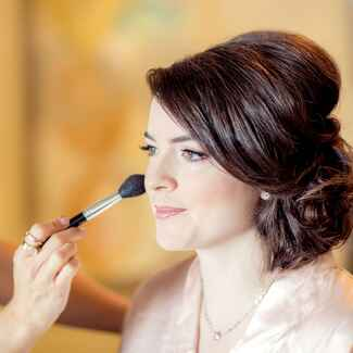 bride getting wedding day makeup