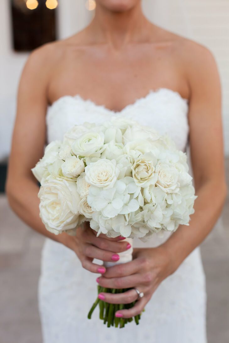 Anne Elise's bridal bouquet consisted of all-white roses, hydrangea and ranunculus for a classic, elegant look.