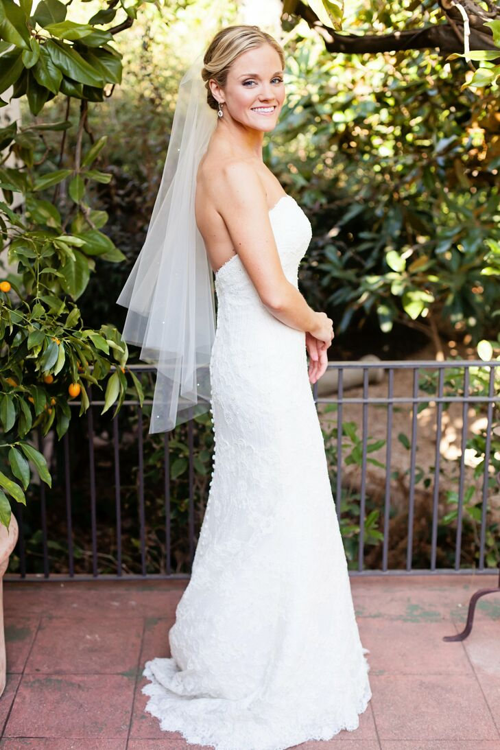Anne Elise wore a classic white sheath wedding dress by Martina Liana with a soft sweetheart neckline, vintage lace detail, lightly beaded with clear Swarovski crystals and finished with a sweep train.