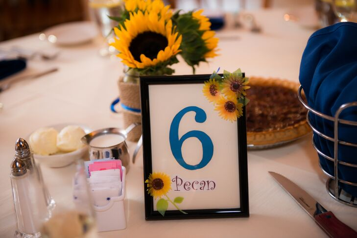 Kristin and Jon titled the table numbers corresponding with the assortment of pies on the dessert table.