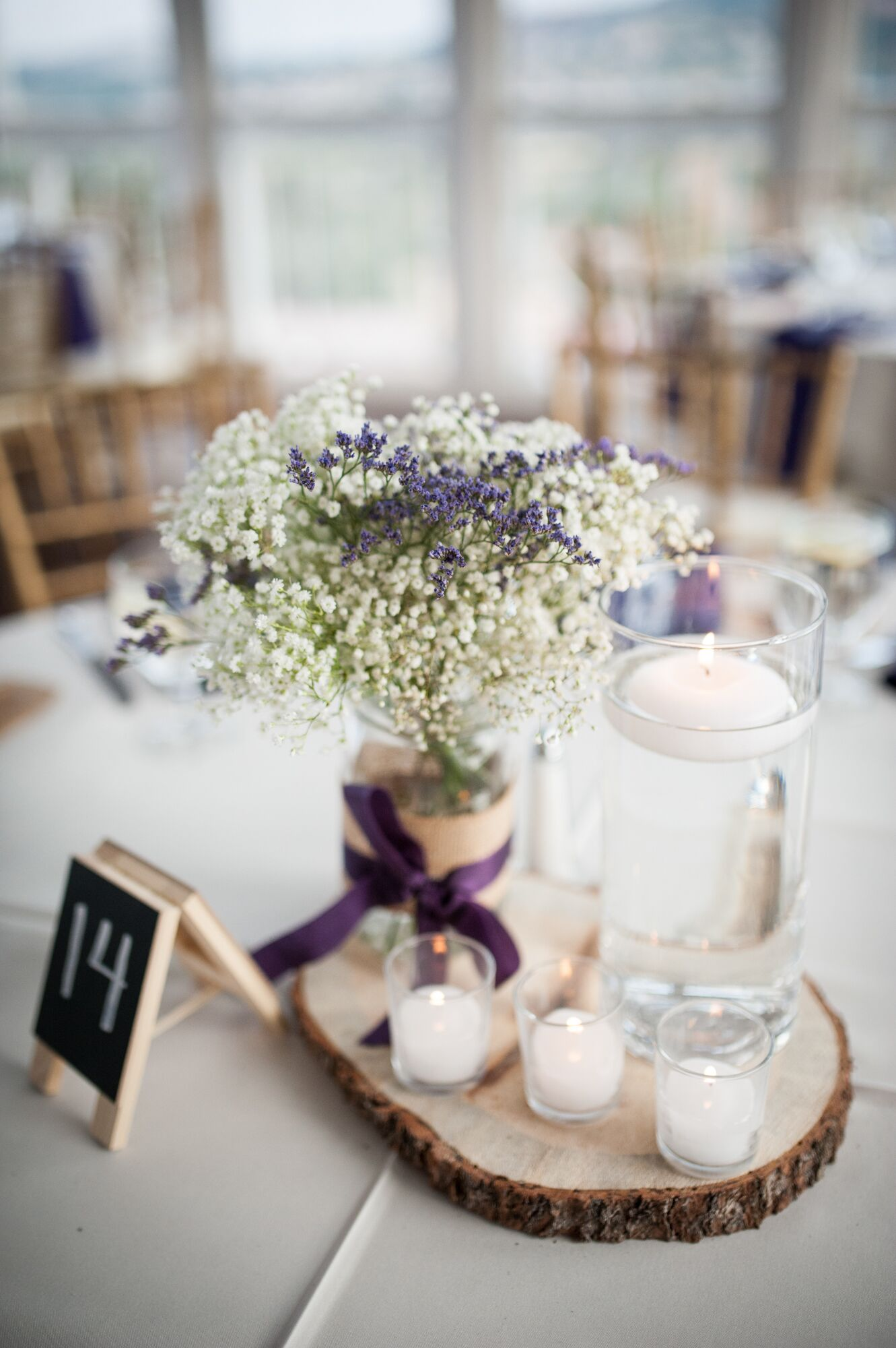 Rustic baby s breath and floating candle centerpieces