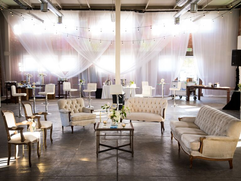 This white lavish furniture setup with curtain backdrop