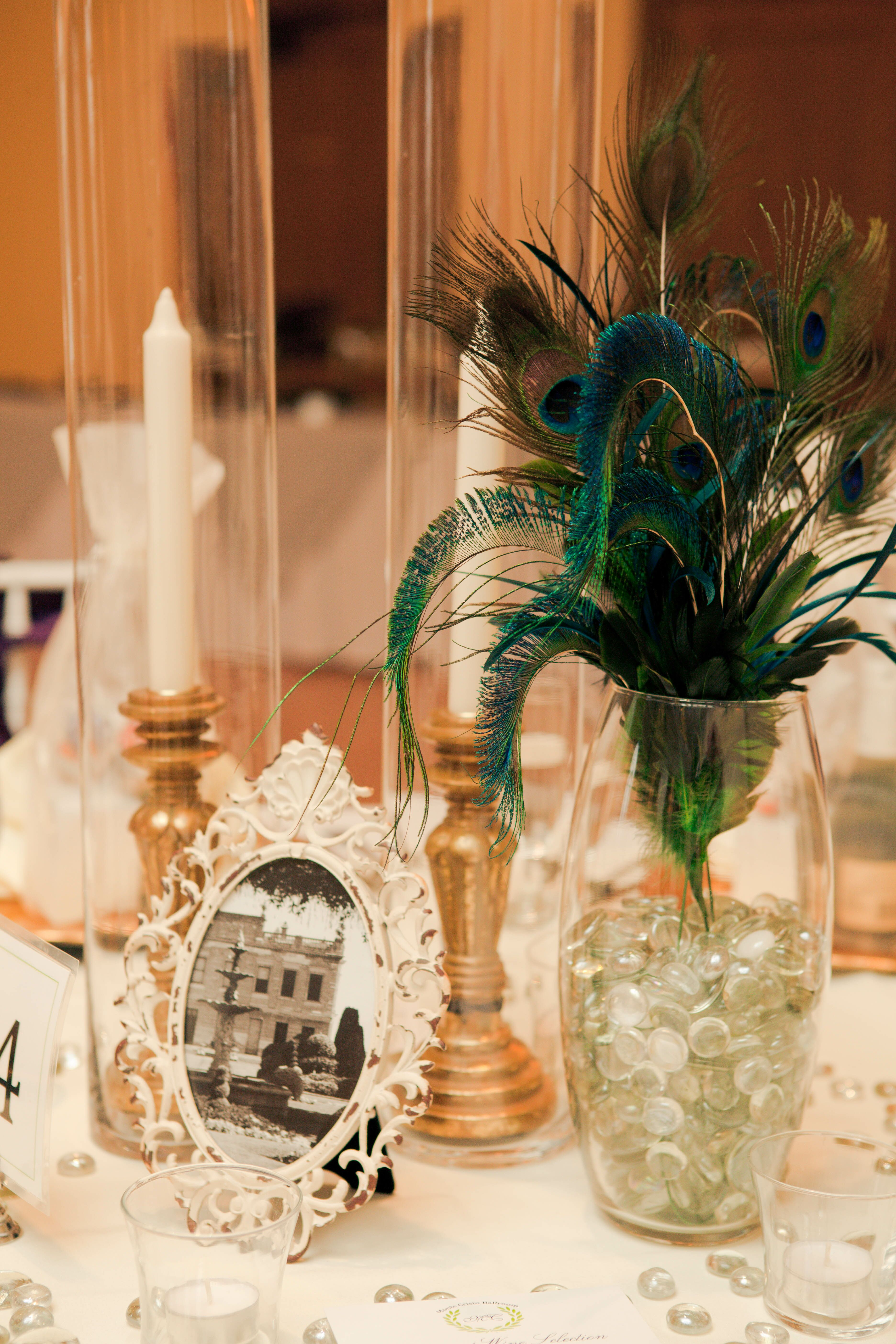 peacock feather centerpiece and candles