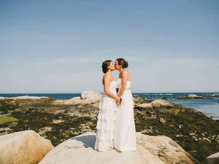 Same sex couple kissing overlooking Kennebunkport, Maine