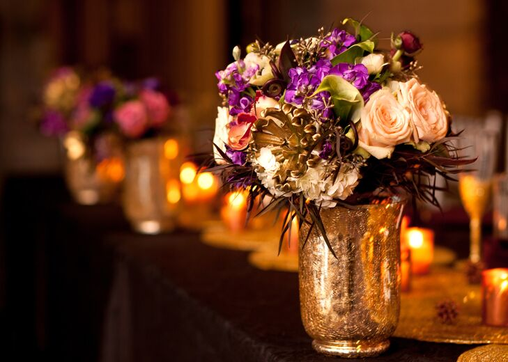 purple and gold centerpiece in gold vase