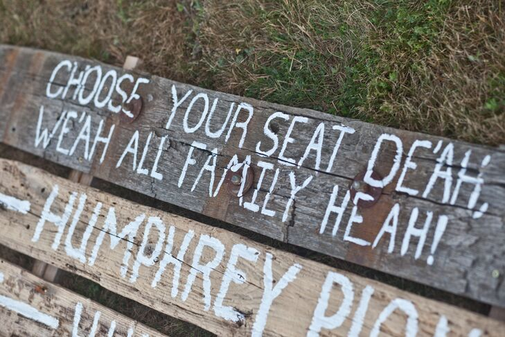 Painted driftwood signs let guests choose their own seat.