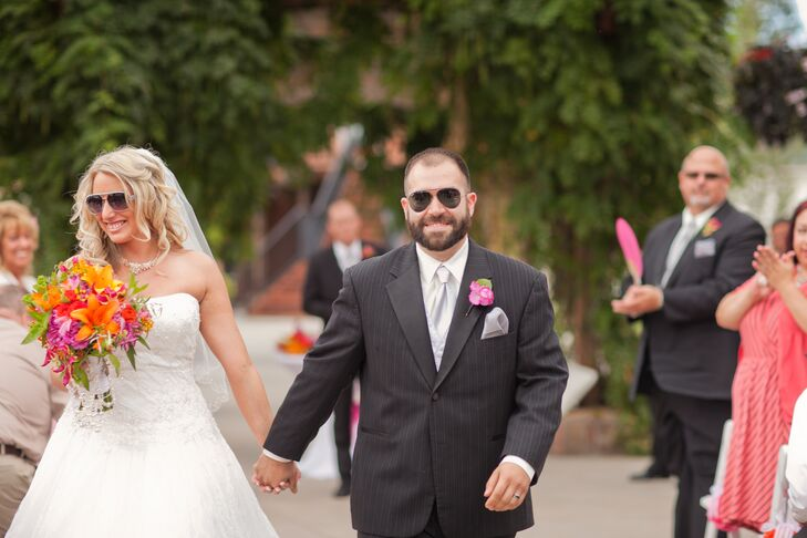 Nikki and James took their first steps as husband and wife to the Top Gun theme song wearing aviator sunglasses.