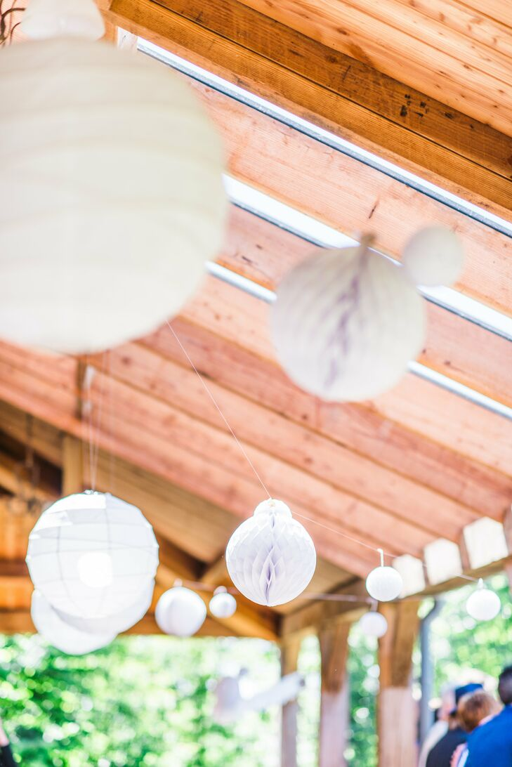 The ceiling of the patio where the festivities took place was strung with hanging paper lanterns and honeycomb balls as a whimsical touch.