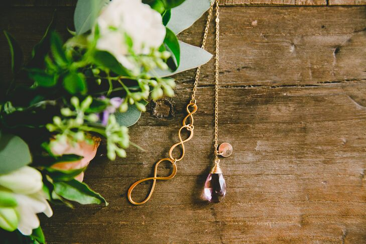 As gifts for her bridesmaids, Esme custom-designed necklaces with a purple ametrine stone and a triple infinity, symbolizing the wedding date—the eighth month (August), the day (the 8th) and the year (2015), which adds up to the number eight.