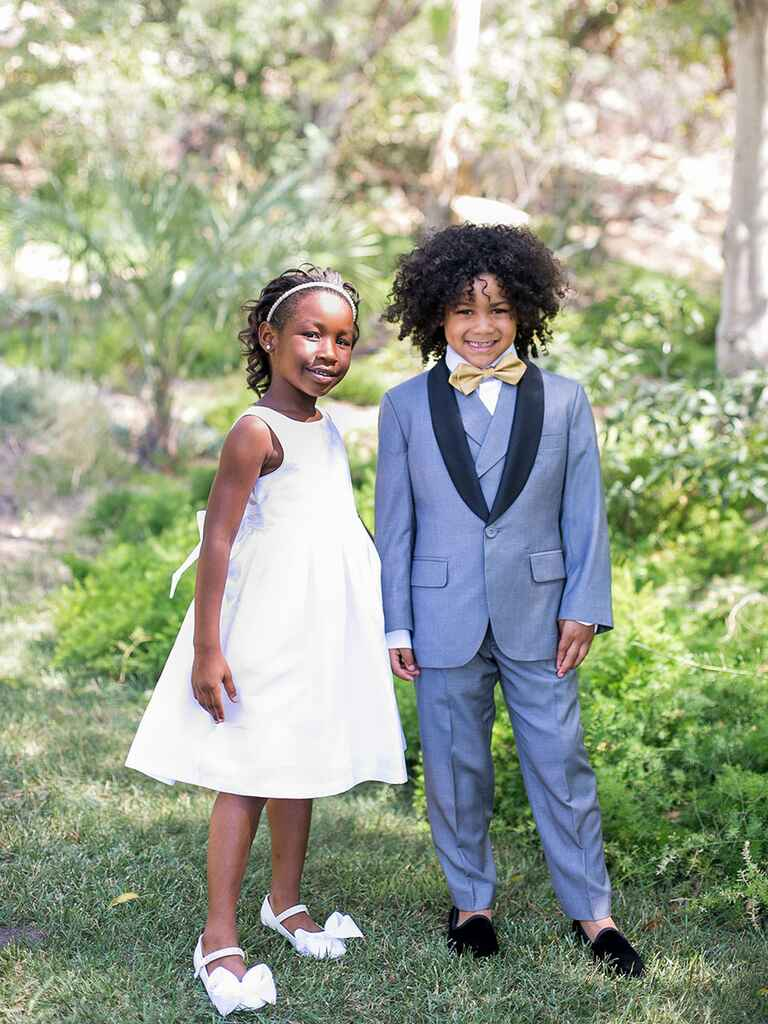 Cute stylish ring bearer flower girl at wedding