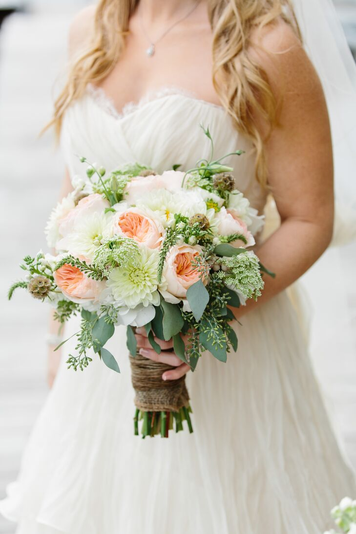 """The only flowers I absolutely had my heart set on were David Austin Roses,"" says Alissa. Dahlias, seeded eucalyptus and scabiosa rounded out her lush bouquet."