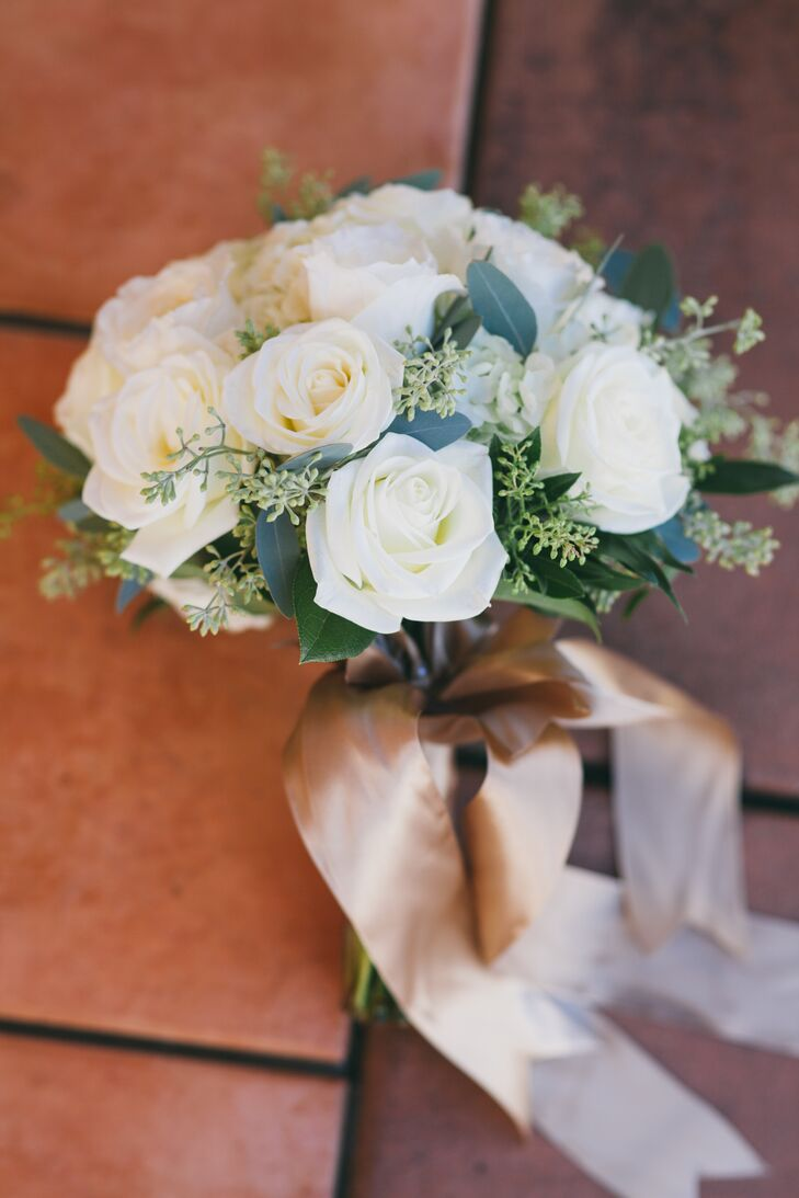 Nadia held a romantic arrangement of ivory roses mixed with eucalyptus and greenery that served as her bridal bouquet. The flowers had a gold ribbon tied around the stems, holding it all together while adding another touch of elegance.