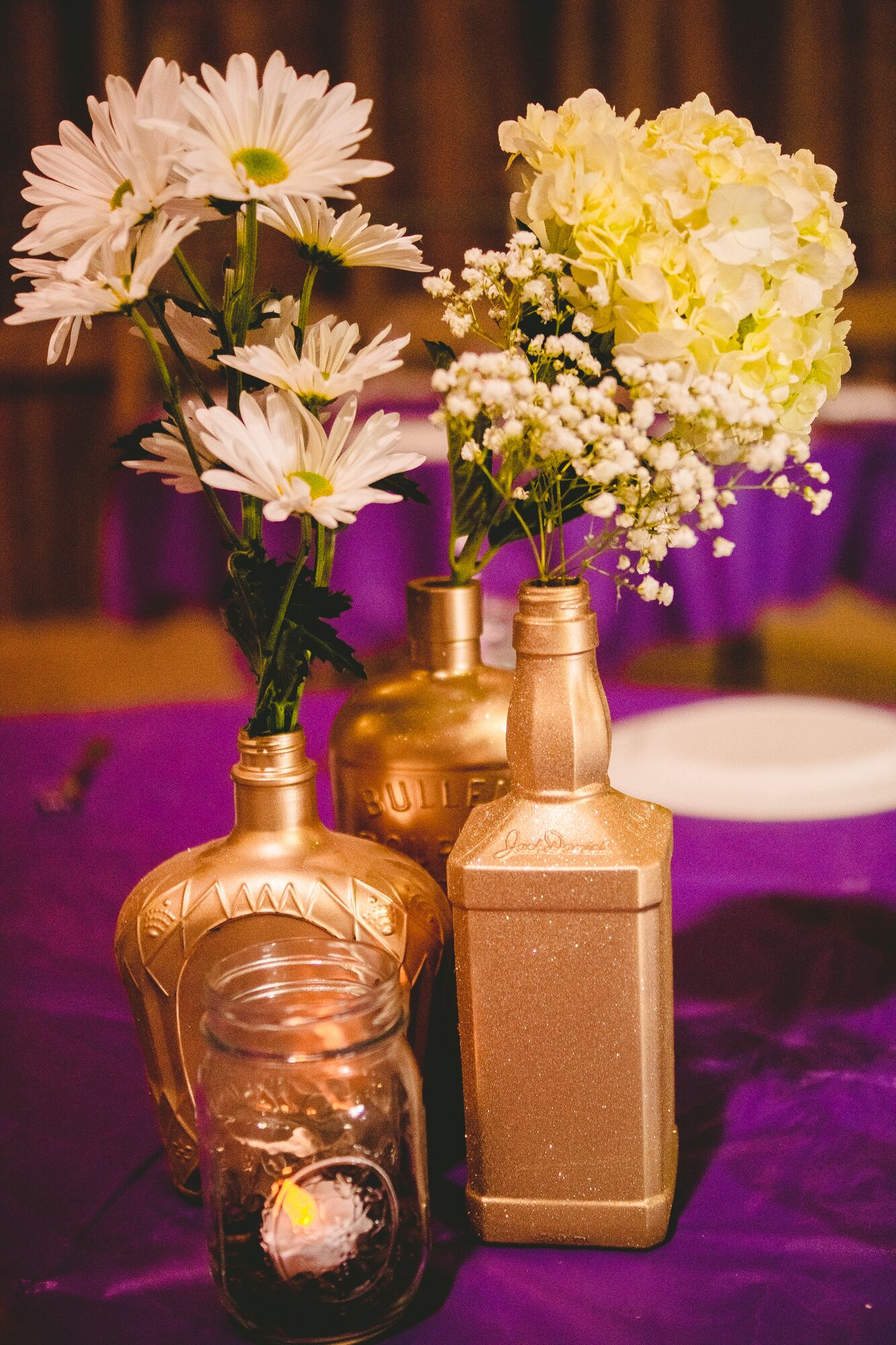 Diy gold bottle centerpieces with fresh flowers