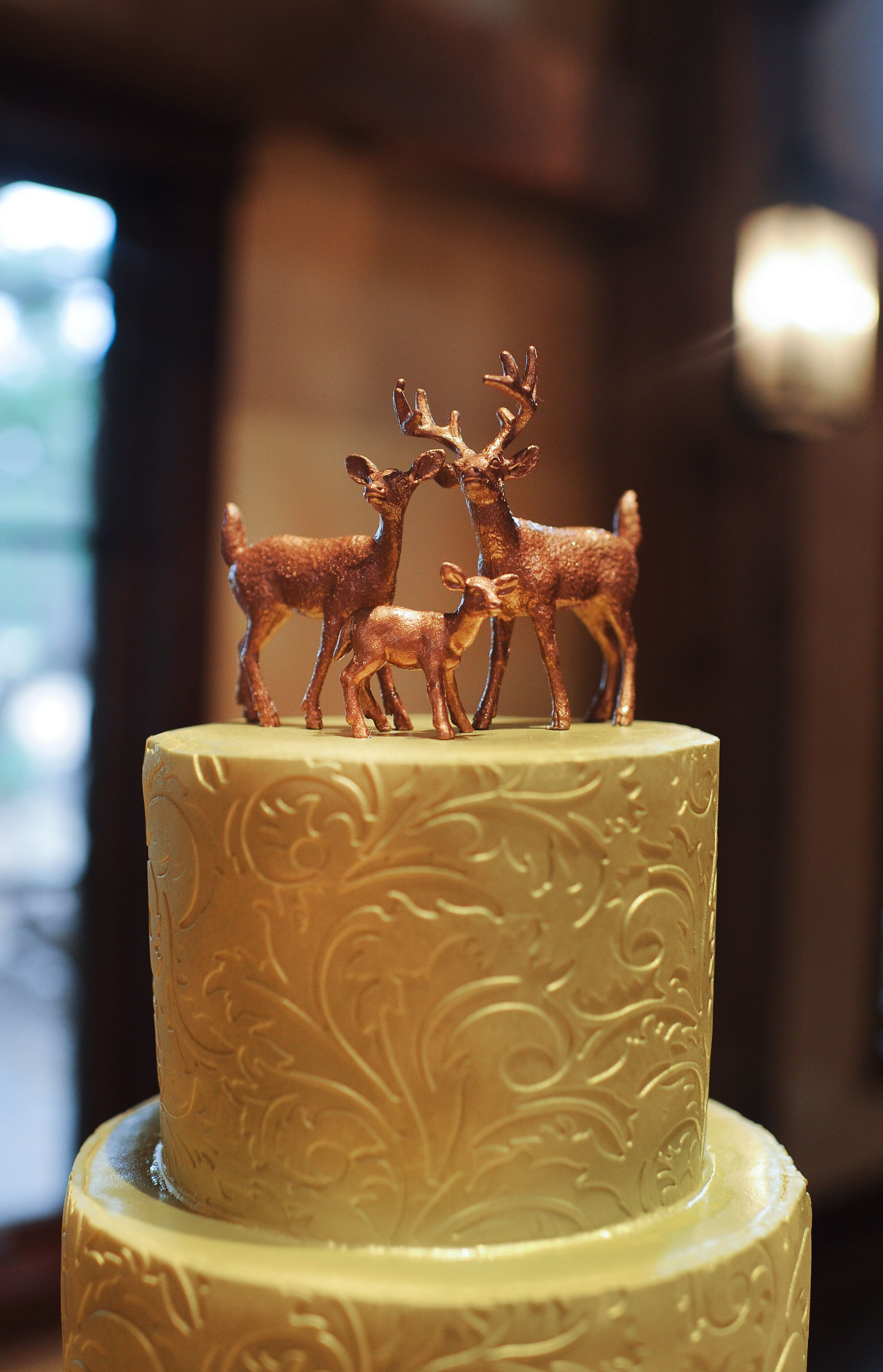 wedding cakes in red deer an ornamental gold wedding cake with rustic deer family 24752