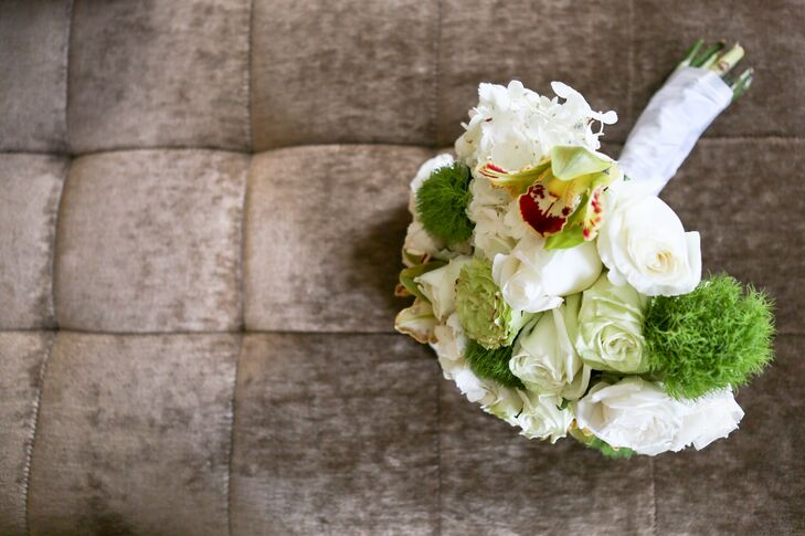 The bridal bouquet was a green and white colored arrangement of roses, hydrangeas and lilies.