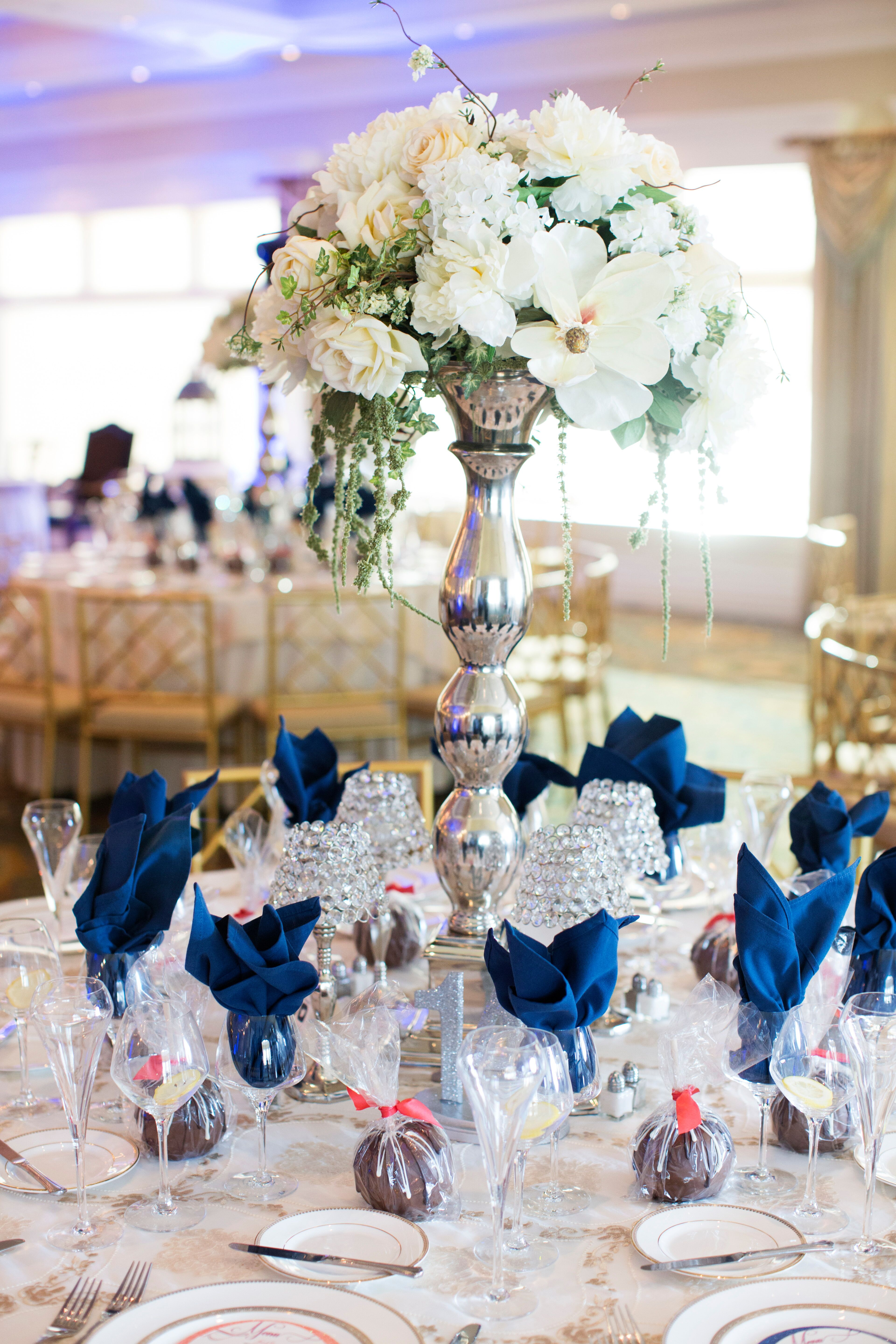 Tall White Floral Centerpieces In Silver Vases