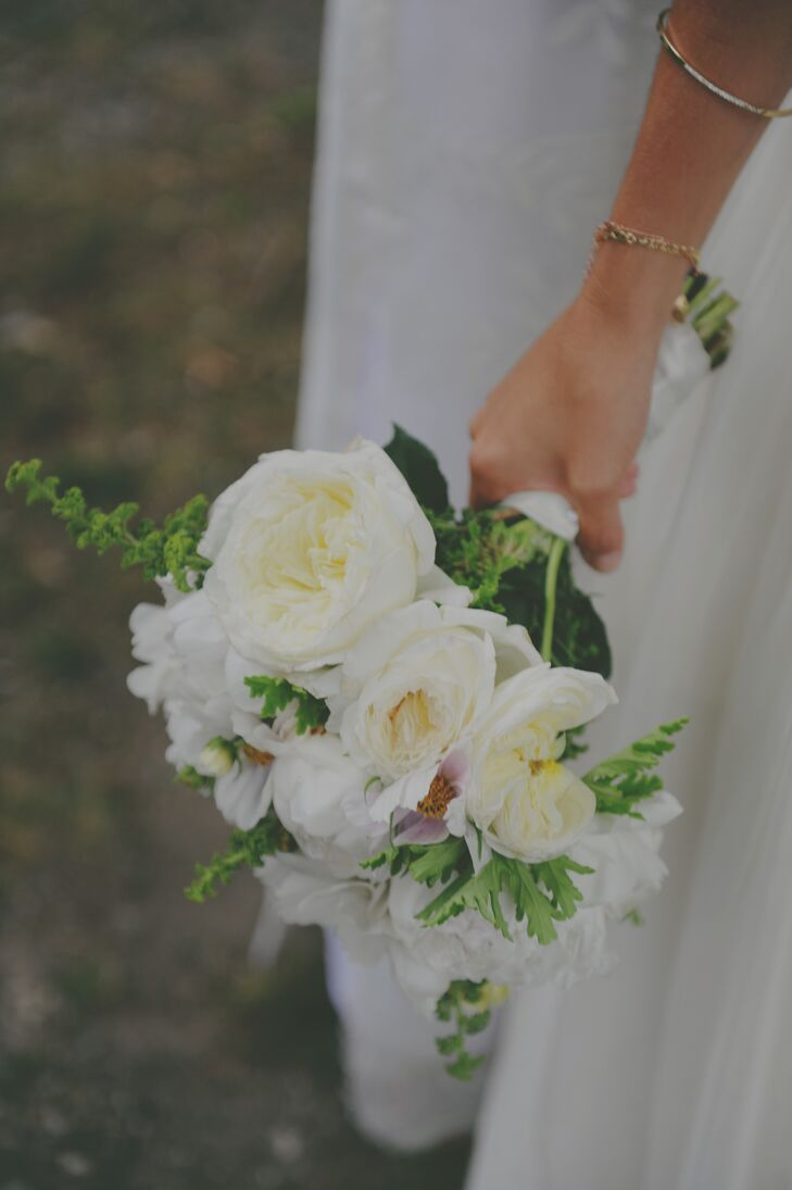 Brittany carried a romantic, ivory bouquet filled with greens and garden roses.