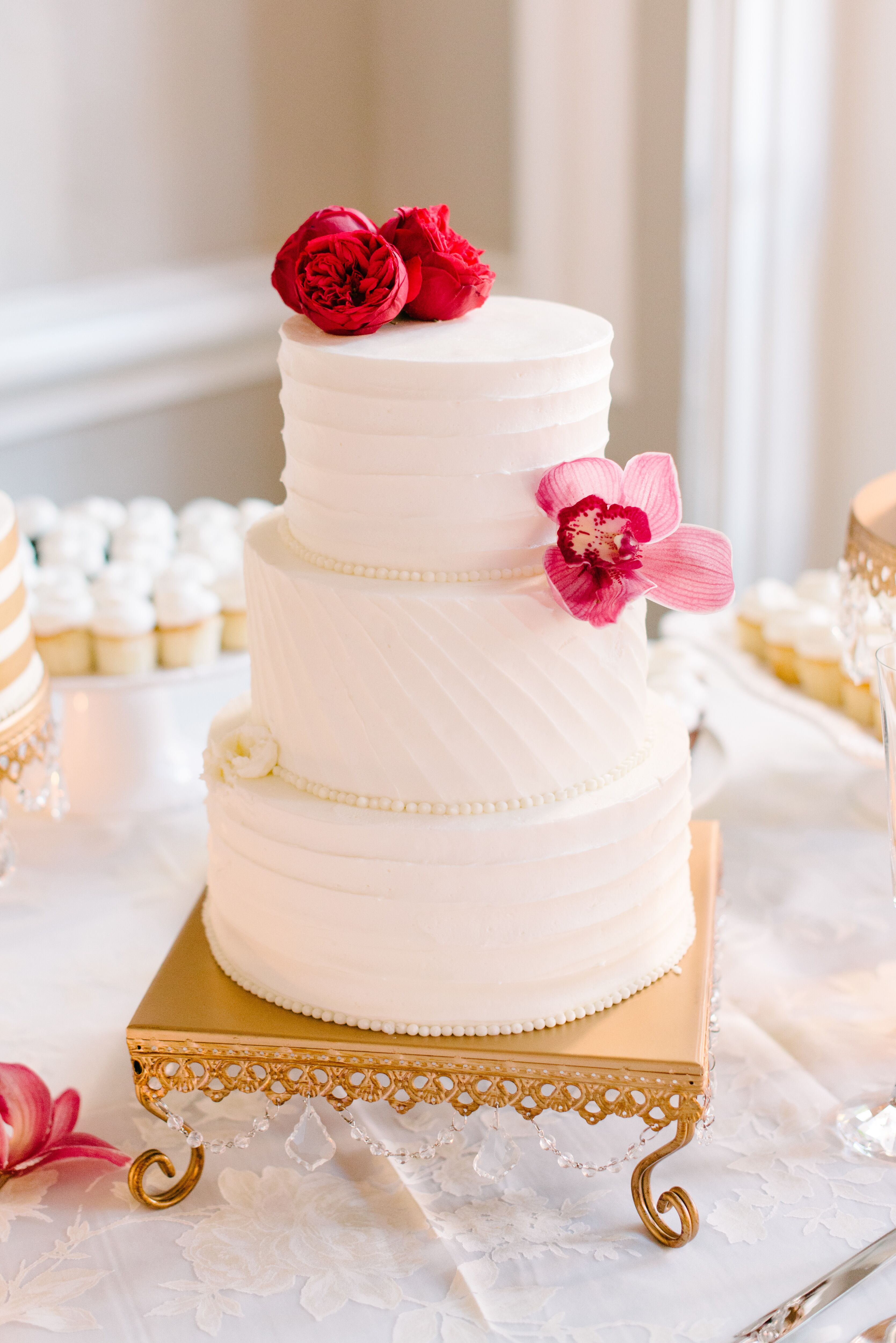 Polished Buttercream Cake with Fresh Flower Accents