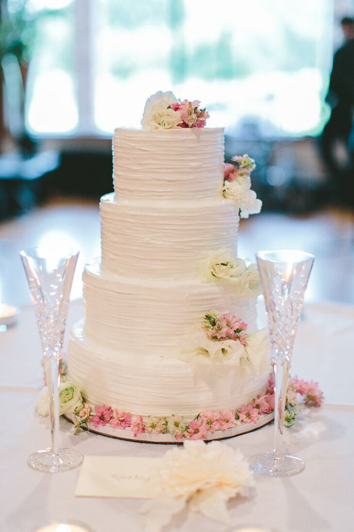 Classic buttercream wedding cake with white and pink flowers mightylinksfo