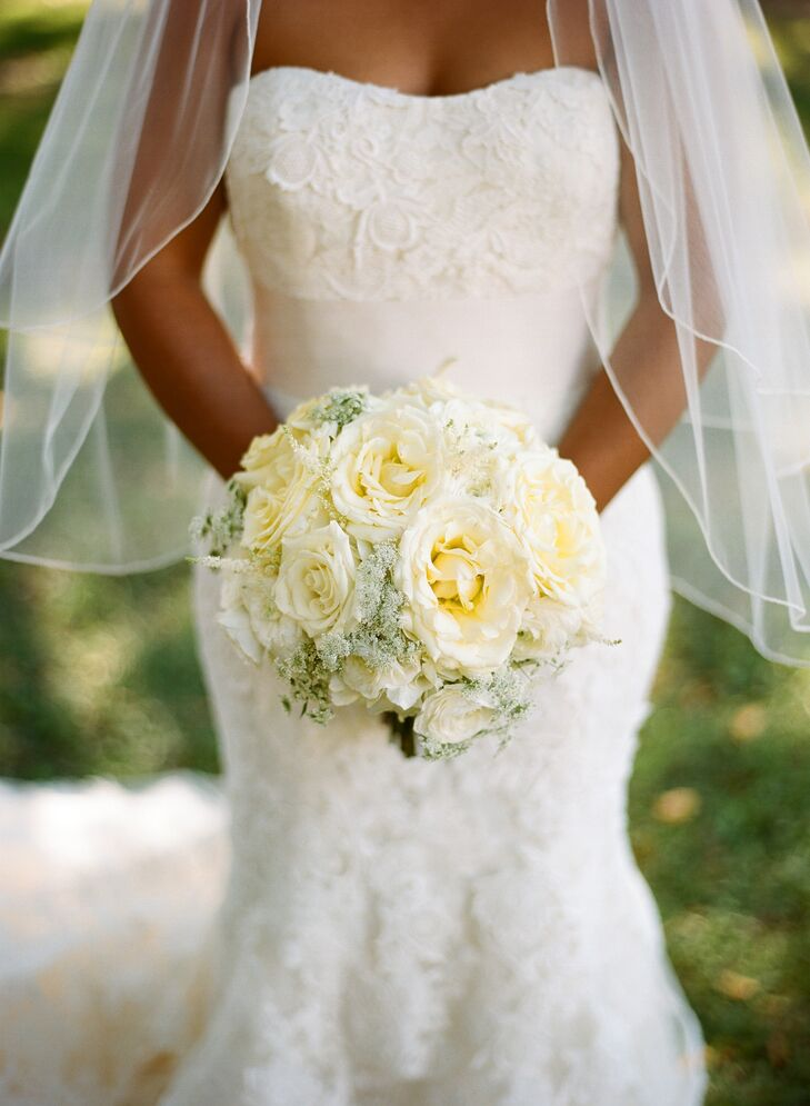 Shalini carried a compact, round bouquet of ivory, hydrangeas, garden roses, ranunculus, astilbe and queens anne lace, tied with a gold ribbon.