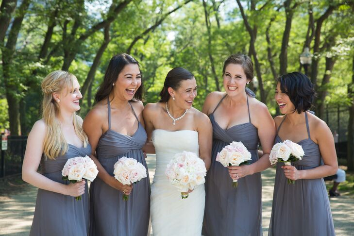 For her walk down the aisle, Emily donned an ivory Vera Wang design that incorporated French tulle and silk organza, while her bridesmaids wore gray chiffon Amsale gowns.