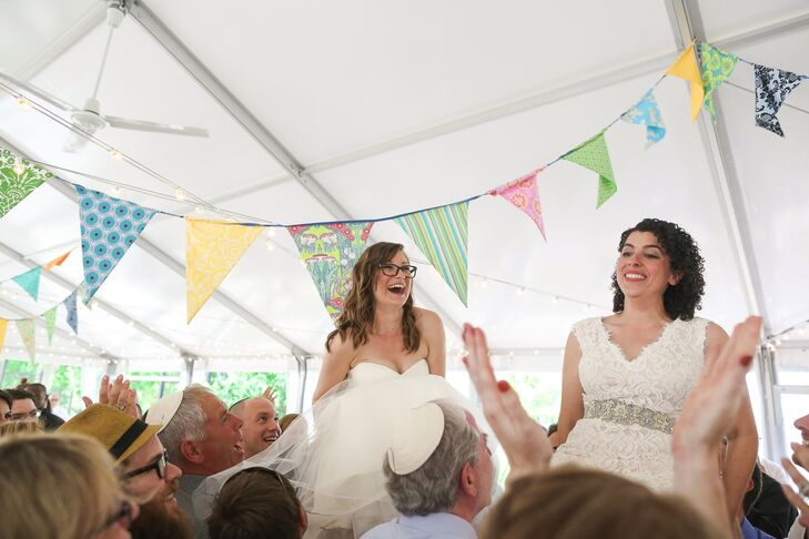 Their location at the American Swedish Historical Museum in Philadelphia, Pennsylvania, inspired every pennant flag that hung above the reception. The accents were made specifically from Swedish fabric prints and hung all over the tent.  During the hora, Elana and Jamie were able to touch each banner as their friends and family members lifted them up.