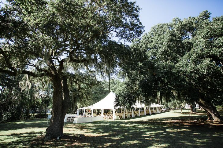 As native Carolinians, Tangie always appreciated the beauty of Sunnyside Plantation in Murrells Inlet, South Carolina. So when it came time to decide where to get married, they couldn't think of anywhere more fitting. After their vows on the water, they celebrated with dinner and dancing in a white sailcloth tent.