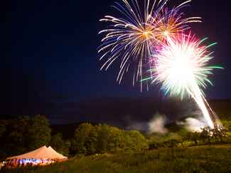 Fireworks over tented wedding reception