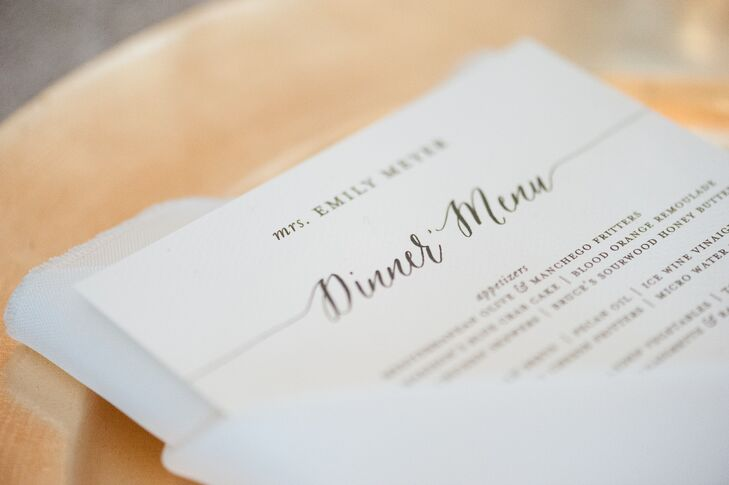 "Paper Daisies Stationery created the timeless black-and-white dinner menus for the reception at Old Edwards Inn and Spa in Highlands, North Carolina. Each menu was topped with a guest's name, so they doubled as place cards. ""I wanted it to feel very intentional and personalized for every guest,"" Emily says."