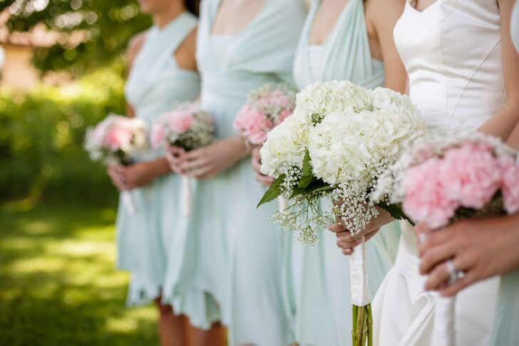The bridal bouquet vividly stood out from the pink bridesmaid bouquets. Bridget's bouquet had purely white blooms: ivory hydrangeas accented with baby's breath.