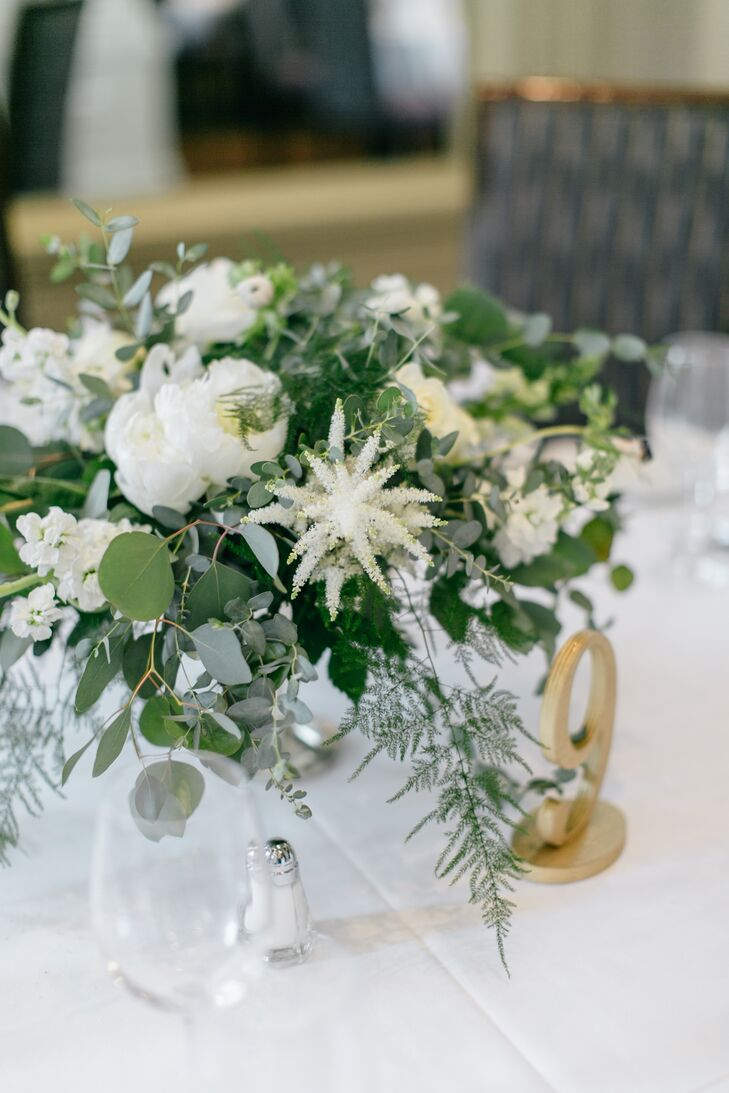 White floral arrangements with gold and silver accents created a soft, elegant, romantic ambiance.