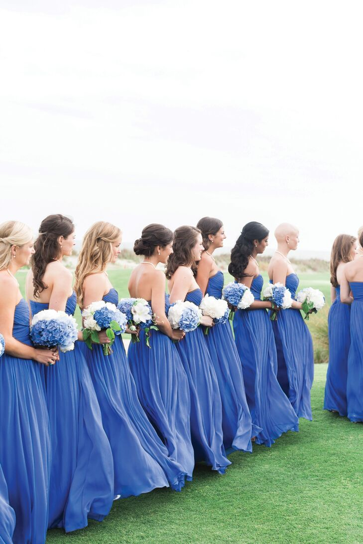 Nicole had 14 bridesmaids for her gorgeous wedding. She chose J.Crew's Arabelle style in casablanca blue to complement her blue color palette and beachfront venue.