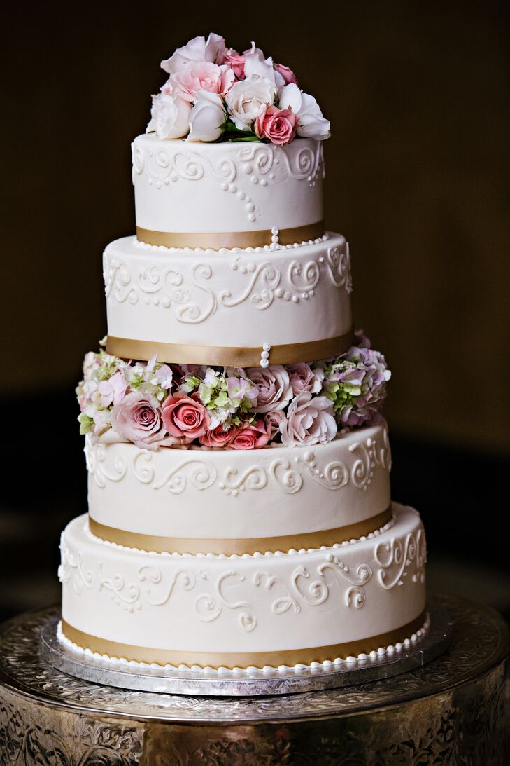 White Wedding Cake with Gold Ribbon and Flowers