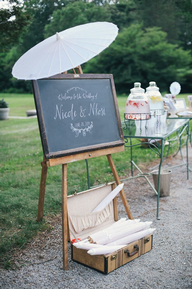 Chalkboard Easel as Welcome Sign and Parasols for Guests