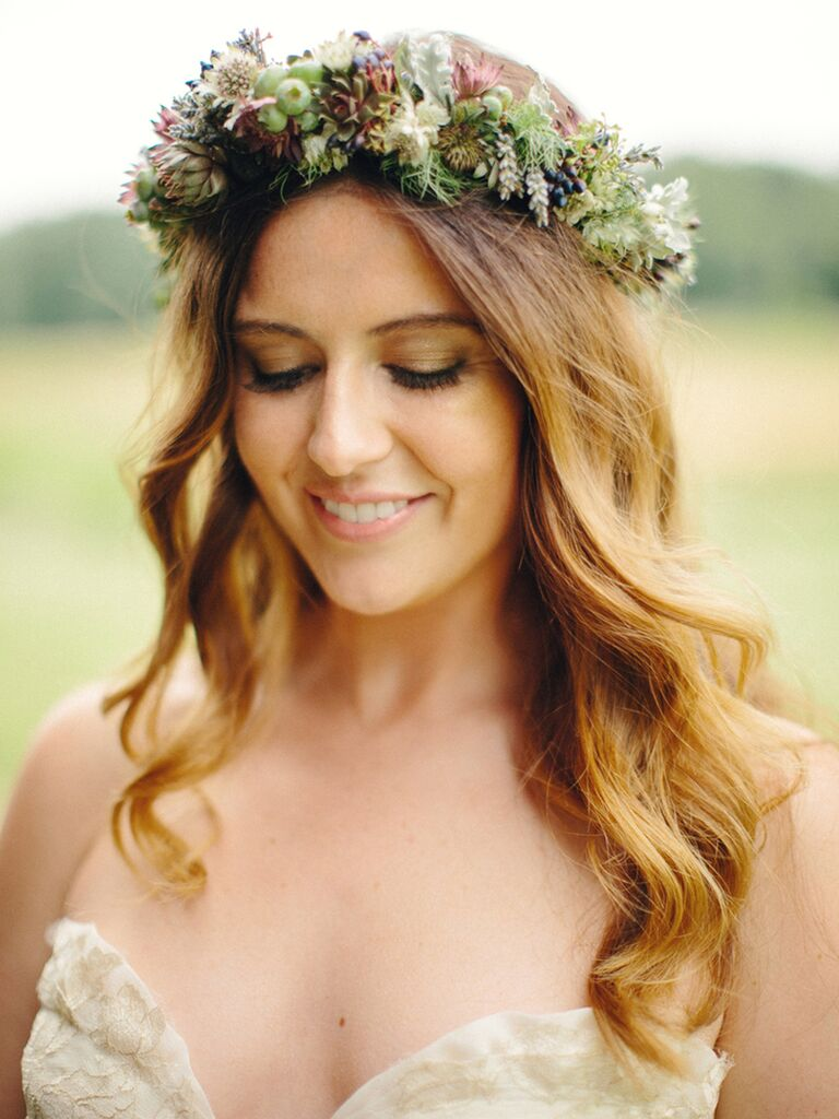 A bride with gold and green eyeshadow wearing a flower crown
