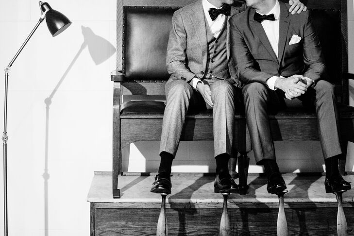 A black-and-white shoeshine photo fit in with the 1920s theme of the wedding at the Chicago Athletic Association in Chicago, Illinois.