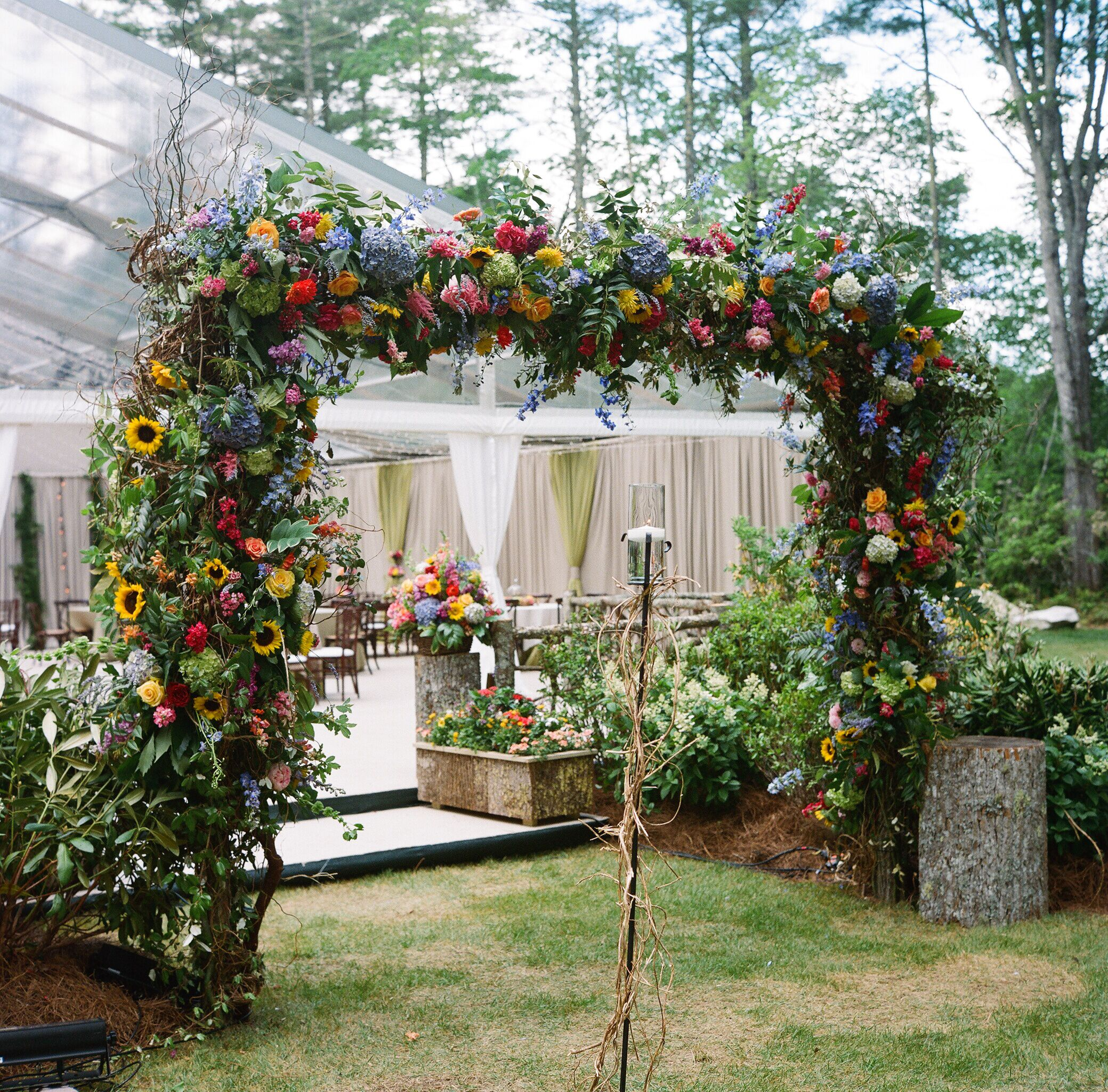Fashion Forest Beauty Salon: Bold Colorful Flower Wedding Reception Arch Entryway