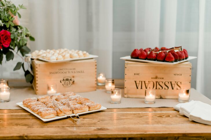 Dulce de Leche eclairs, chocolate mousse-filled strawberries dipped in ganache, and key lime meringue tarts were displayed on wooden wine crates.