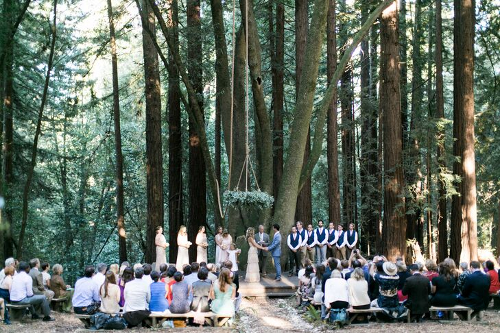 """Shiloh and his father built the ceremony space and benches from redwood trees on the property,"" Liz says. ""We didn't decorate it much because it was beautiful as it was. We just added a grapevine wreath that I bound with fresh eucalyptus, and Shiloh suspended it from the tree with 100 feet of rope."""