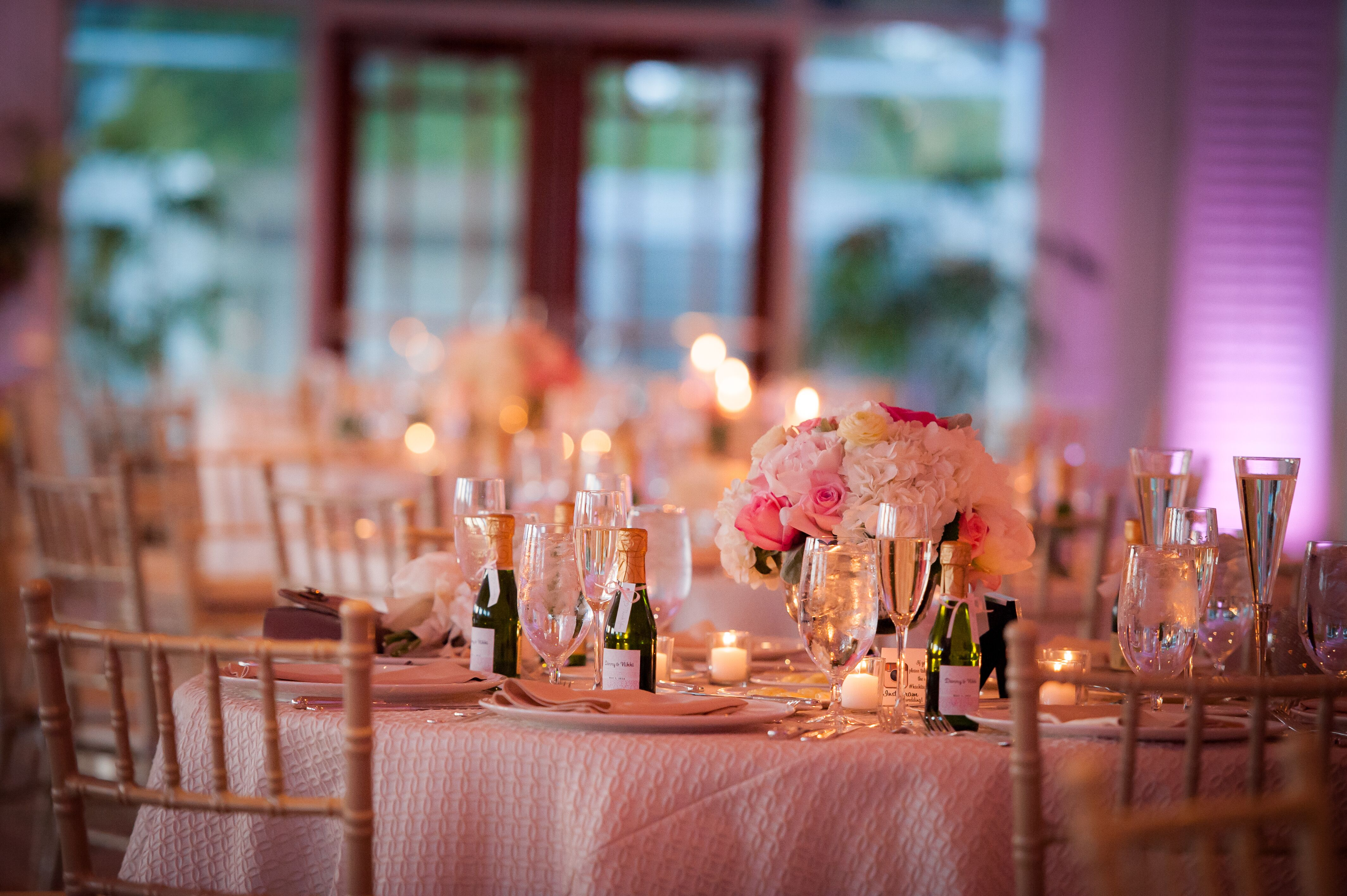 Reception Dinner Table With Mini Champagne Bottle Wedding